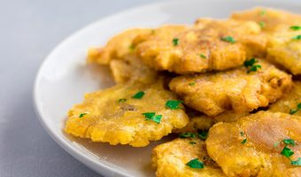 plate of tostones with cilantro garnish and salt recipe