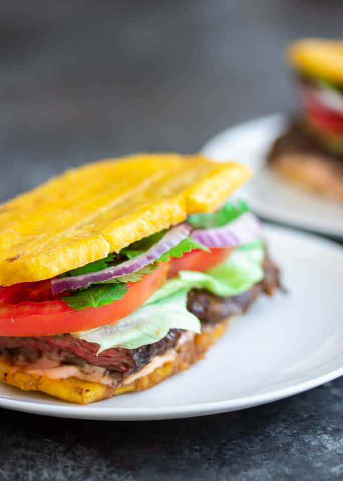 plantain jibarito sandwich with churrasco steak tomatoes onions lettuce mayo ketchup cilantro