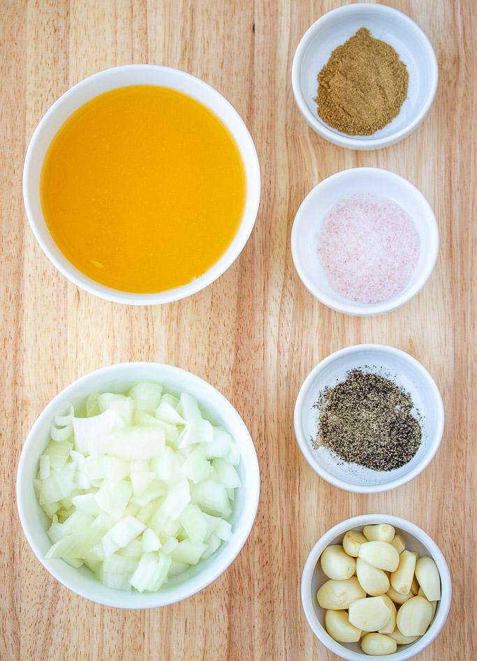 naranja agria chopped onions salt pepper garlic oregano powder in seperated bowls